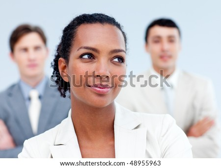 Charming young business people standing with folded arms - stock photo