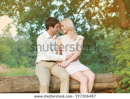 Charming young couple in love outdoors - stock photo