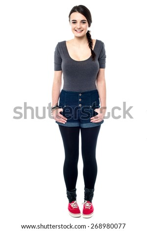 Charming young girl in stylish fashion attire. - stock photo