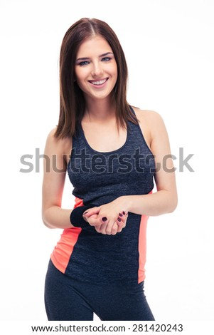 Charming young happy fitness woman standing isolated on a white background and looking at camera - stock photo