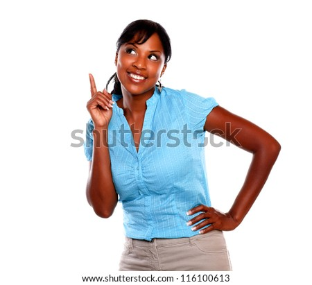Charming young woman on blue blouse pointing up on isolated background - copyspace - stock photo