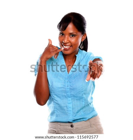 Charming young woman pointing at you and saying call me against white background - stock photo