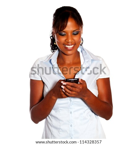Charming young woman sending message by cellphone on isolated background - stock photo