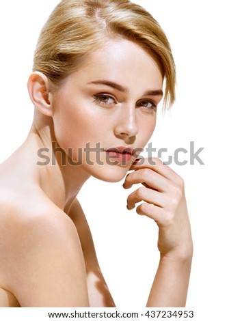 Charming young woman with perfect make up. Close up of an attractive girl of European appearance on white background. Youth and skin care concept - stock photo