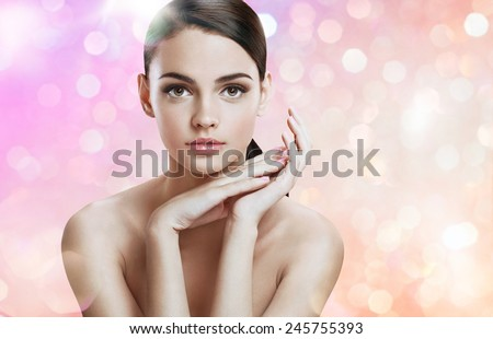 Charming young woman with perfect makeup, skin care concept / photoset of attractive brunette girl on blurred pink background with bokeh  - stock photo