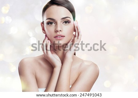 Charming young woman, youth and skin care concept / photoset of attractive brunette girl on blurred background with bokeh  - stock photo