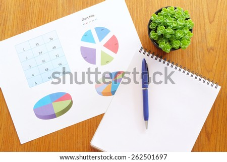 chart on the wooden table  - stock photo