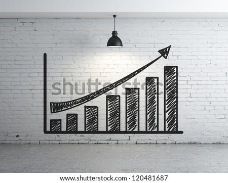 chart profit on brick wall - stock photo
