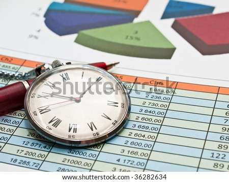 Chart with clock and pen - stock photo