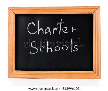Charter Schools written on chalkboard - stock photo