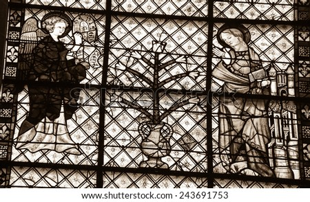 CHARTRES, FRANCE - APRIL 14, 2013: Annunciation of Angel Gabriel to the Blessed Virgin Mary on the stained glass window in Chartres cathedral. Chartres cathedral was built between 1194 and 1250. - stock photo