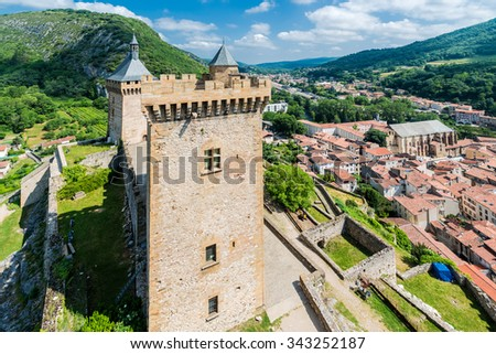 Chateau de Foix castle overlooks this town of Ariege in Midi Pyrenees, France. - stock photo
