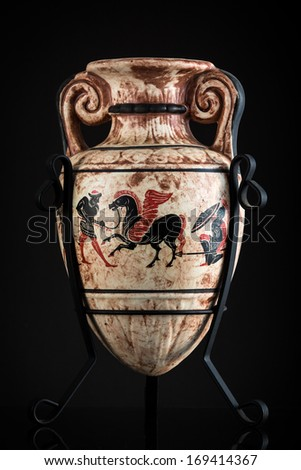 CHATHAM, NJ - JANUARY 2, 2014: Ancient Greek vase sold as a souvenir in Rhodes. The vase depicts Pegasus, a winged stallion sired by Poseidon in his role as horse-god. - stock photo