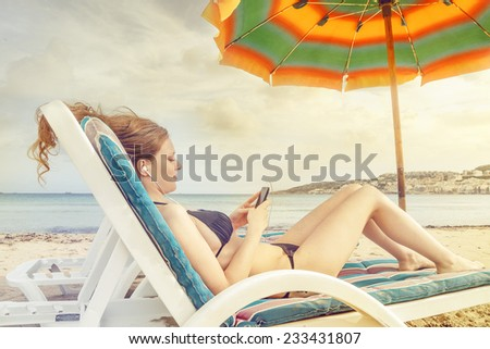 Chatting at the beach  - stock photo