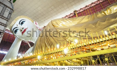 Chauk htat gyi reclining buddha (sweet eye buddha), yangon, myan - stock photo