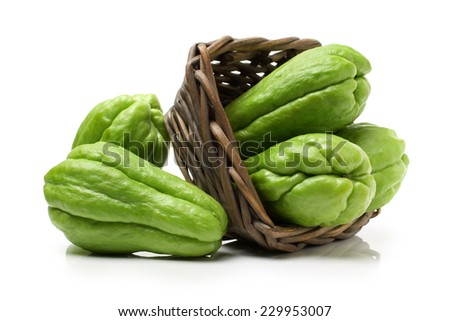 chayote chokos in basket on white background.  - stock photo