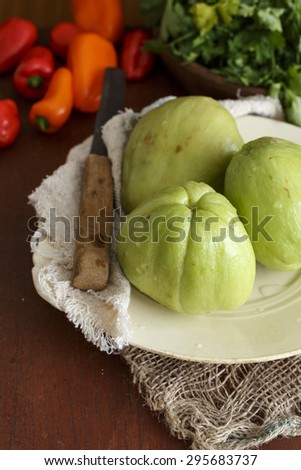 Chayotes on a plate ,fresh from market - stock photo