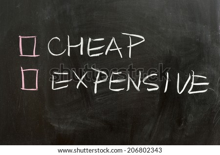 Cheap or expensive options on the chalkboard - stock photo