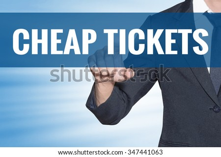 Cheap Tickets word Business man touching on blue virtual screen - stock photo