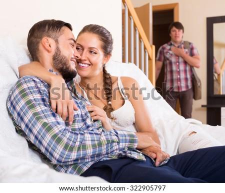 cheating partner having unfaithfulness woman at home - stock photo