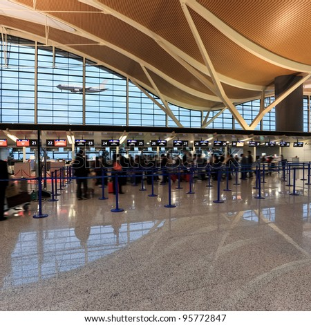check in at airport hall in shanghai - stock photo