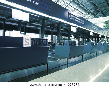 Check in counter in airport - stock photo