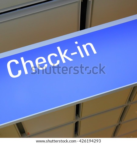 Check-in sign in an airport - stock photo