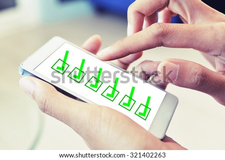 check list on smart phone - stock photo