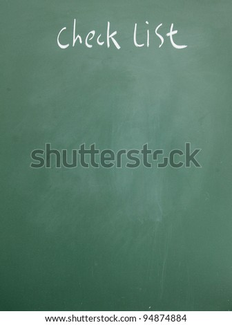 check list written with chalk on blackboard - stock photo