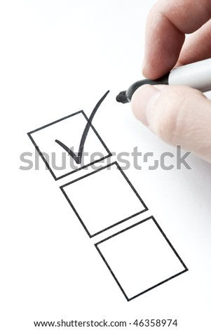 Check Mark and Box with Hand Writing. Focus on check mark in box.. - stock photo