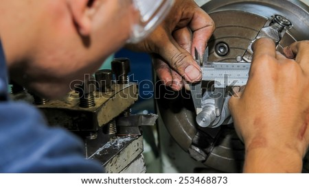 Check measurement of blank in attachment by digital hand caliper and Micrometer - stock photo