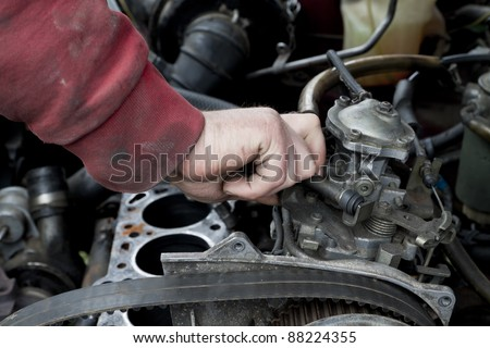 Check out of broken car engine - stock photo