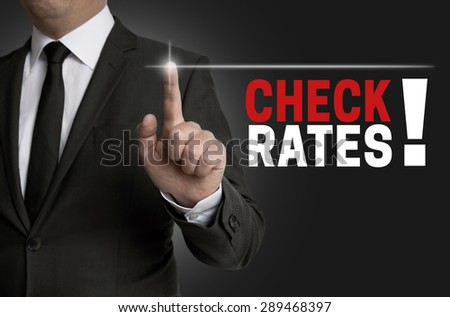 Check rates touchscreen is operated by businessman. - stock photo