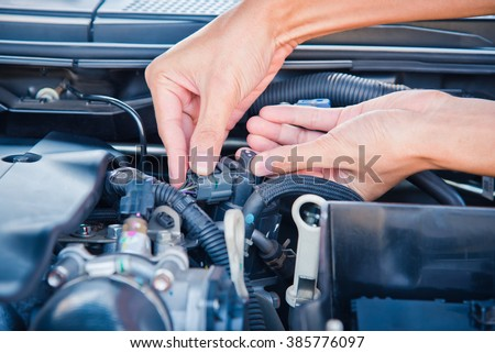 Check the condition of the car engine. - stock photo
