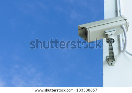 Check the movement of the traffic cameras. The sky as a backdrop. - stock photo