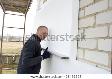 check to accuracy of the installation polyfoam plates - stock photo
