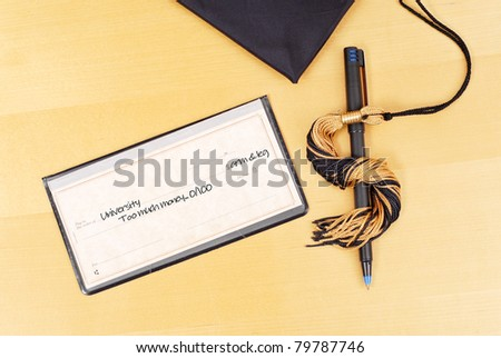 Check with Pen and Tassel in Shape of Dollar Sign - stock photo