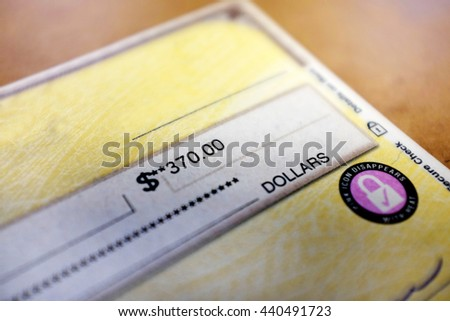 Check written out with payment amount - stock photo