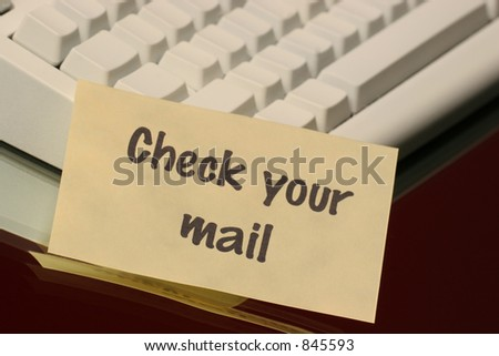 check your mail message on the keyboard - stock photo