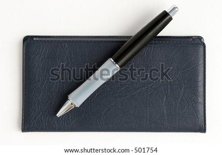 Checkbook and pen - stock photo