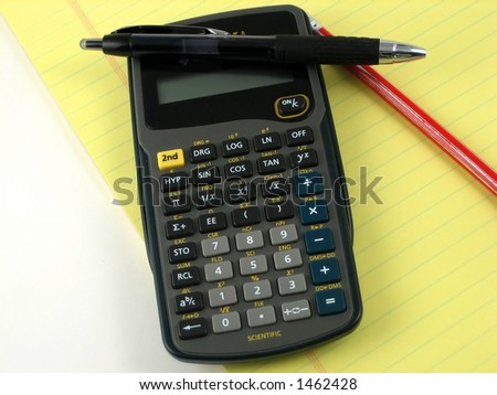 Checkbook, notepad and calculator used to make financial decissions - stock photo