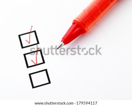 Checkbox and pen - stock photo