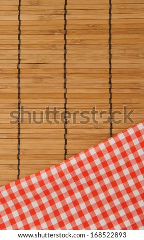 Checked tablecloth on bamboo background  - stock photo