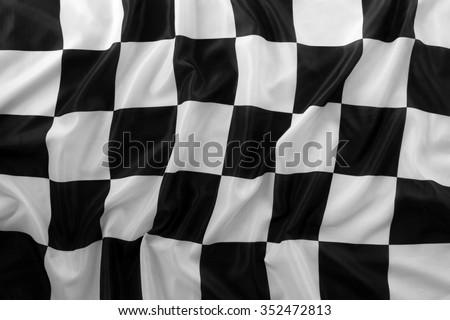 Checkered black and white flag closeup - stock photo