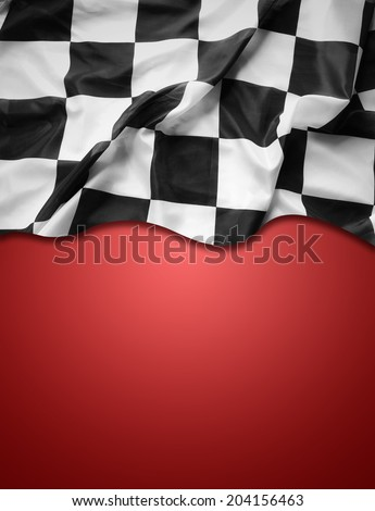 Checkered black and white flag on red background. Copy space - stock photo