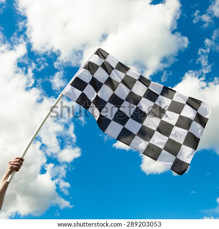 Checkered flag waving in the wind - close up shot - stock photo