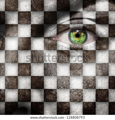 Checkers board or finish flag on male face with green eye - stock photo