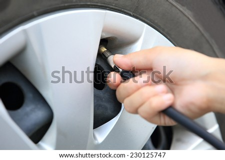 Checking /add air pressure . pumping air into auto wheel. vehicle safe concept.  - stock photo