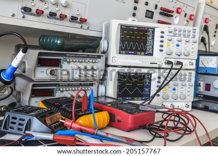 checking and repairing faulty solar regulator using an oscilloscopes - stock photo