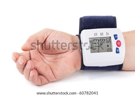 Checking blood pressure at the wrist - stock photo